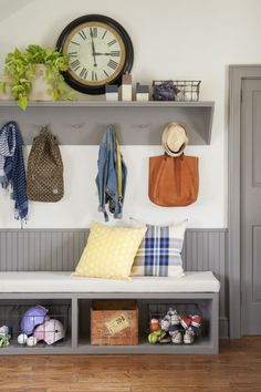 Jami and Page carved out a utilitarian space off the garage entry by installing a cushion-topped bench (perfect for slipping shoes on and off) complete with storage cubbies and baskets. Mounted above, a wood shelf with shaker pegs keeps frequently used items like hats and bags off the floor and within quick reach.