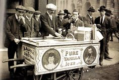 An ice cream vendor and his customers on the streets of London, 3 January 1921