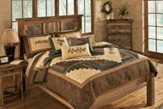 """Complete your lodge look with an eye-catching Donna Sharp quilt.  Sizes: Full/Queen  (90"""" x 90""""),  King  (110"""" x 102"""")."""