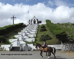 There are many enticing places to go horseback riding in the Azores. This picture is taken in front of Nossa Senhora da Paz, above the town of Vila Franca do Campo