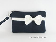 SUPER SALE Navy with Little Ivory Bow Clutch iPhone by LovelyBag, $9.90 http://fashionbagarea.blogspot.com/  $159 Want! #chanel channel bags,channel for men,channel for women,chanel handbags