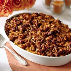 sweet potatoes, baked and mashed  1 cup sugar  1/3 cup margarine, melted  1/2 cup milk  2 eggs, beaten  1 teaspoon vanilla extract  TOPPING  1 cup grated unsweetened coconut, dried or fresh  1 cup pecans  1 cup brown sugar  1/3 cup all-purpose flour  1/3 cup margarine