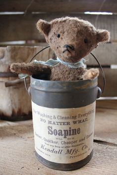 A wee little bear made by me - tucked in an old handled tin with a newly made label. The bear will come out of the can, if you wish to display it differently. Bear is 5'' high - sitting Can is also 5'' high SOLD ~*~ 1 of 2