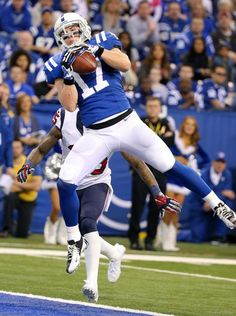 Indianapolis Colts Griff Whalen hauls in a touchdown pass over Houston Texans Kareem Jackson.
