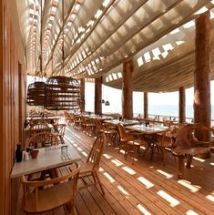 nice semi outdoor feel of a bar by the beach. Bar Bouni in Costa Navarino, Greece. Cafe Restaurant, Outdoor Restaurant Design, Seaside Restaurant, Restaurant Photos, Restaurant Concept, Restaurant Interior Design, Cafe Bar, Seafood Restaurant, Bar Lounge