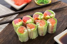 tuna and salmon spring rolls with rice paper, lettuce, and avocado