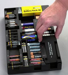Keep batteries neat and organized in a closet workshop or kitchen with this Battery Storage Rack with Battery Tester. This battery organizer accommodates up to ten AAA twelve AA eight C eight D and four 9V batteries and features a battery tester with a colored LED light display to take the guesswork out of batter