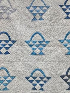 Detail, Beautiful Blue & Soft White Handmade Antique Quilt Flower Basket Pattern Ca 1900; see the spiderweb hand quilting in the open blocks, eBay patriciaquiltsandmore