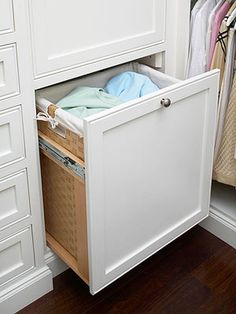 """Corral dirty laundry with a space-savvy storage solution borrowed from the kitchen"". -BHG for small bath solutions"