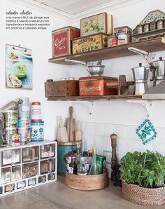Open kitchen shelving and vintage tin storage <3