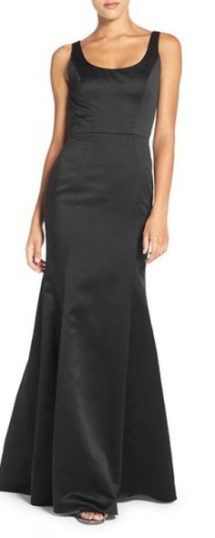 Flattering slim fit black satin gown with glamorous trumpet silhouette  will make every bridesmaid feel special.