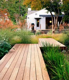 r o b s t e i n e r g a r d e n s.                     I just love the combination of wooden decking walkways and native grasses!