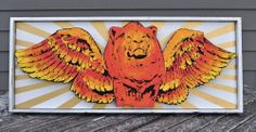 "King of the Sky Flying Lion Folk Art Sculpture on wood. Lion is cut from a piece of wood and mounted to look like it's ""flying"" in mid air. Wooden sculpture for your wall by Rob Johnston, Johnston America"