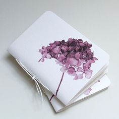 Original pinner sez: Watercolor hydrangea notebooks by Pumpkinsputnik Papergoods... inspiration.... would be simple to make my own mini w.c. journals out of larger sheets of w.c. paper