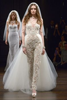 """Giava"" wedding jumpsuit with a V-neckline, raffia embroidery, and a tulle overlay skirt"