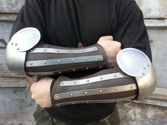 Splinted armor first appears in classical antiquity and later reapears in 14th century. Bracers with elbow cops provides reliable protection against wooden, plastic or steel weapon.