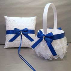 Customize your wedding with this beautiful royal blue on ivory or white satin and embroidered lace flower girl basket and ring bearer pillow set.