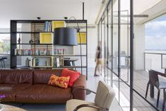 Image 5 of 19 from gallery of The Bash Residence / SO Architecture. Photograph by Shai Epstein Architecture Photo, Shelves, Couch, Living Room, Gallery, Outdoor Decor, Projects, Furniture, Home Decor