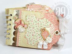 Baby's Mini Tag Album using four or five different Graphic 45 collections. By Annette Green.
