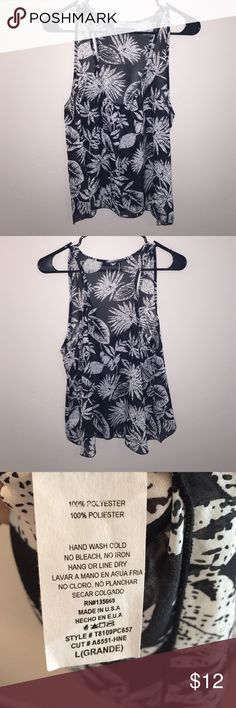 Black and white flowy flower tank top! Cookies Hawaii brand flower tank top. Great condition only worn a few times. Tops Tank Tops