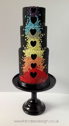 Black version of the popular rainbow blossoms wedding cake. Also suitable for anniversaries and other occasions. Black really makes those colours pop!