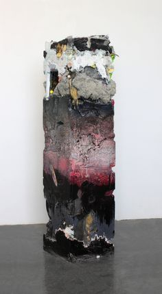 """jack henry,   Untitled (Core Sample #22). Found objects, gypsum cement, pigment and acrylic. 52"""" x 14"""" x 14""""."""
