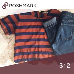 Burnt orange & navy blue cropped blouse Burnt orange and navy blue striped cropped blouse with scalloped detailing. Has a cute zipper in the back. Worn a few times. Pair with high waisted jeans and boots or a midi skirt. Tops Blouses