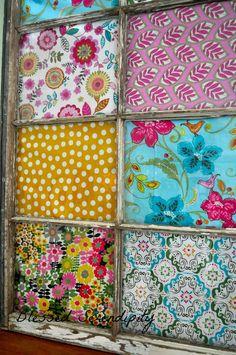 Beautiful way to display favorite fabrics in an old window frame.