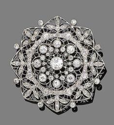 A diamond brooch, circa 1910. Of floral design, finely pierced and millegrain-set with old brilliant and single-cut diamonds, to a similarly-set diamond suspensory loop, diamonds approx. 2.90cts total.