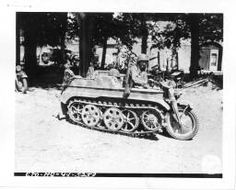 Pvt Steve Barney, Kilgore, Idaho, tries out captured German half-track motorcycle in Carentan, France. Captured German equipment is providing much of the transport used by airborne troops who landed in France. Pvt Barney, 506th parachute inf. 17 june = [Le para Steve Barney essaie une moto chenillée allemande]. http://recherche.archives.manche.fr/?id=recherche_documents_figures