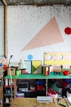 studio workspace. I love the wall.