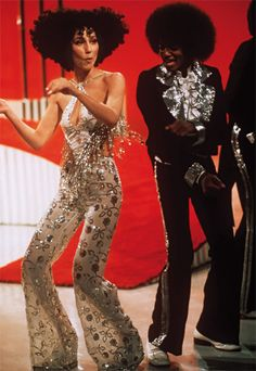 "1974  Cher boogied with the ""adorable"" Michael Jackson and his brothers on her variety show. The hair was ""an Afro but in a Cher way""; the beaded halter and floral bell-bottoms were pure Mackie. ""We spent hours on fittings,"" she says. ""Bob told me if I got any thinner he would stop making clothes for me."""