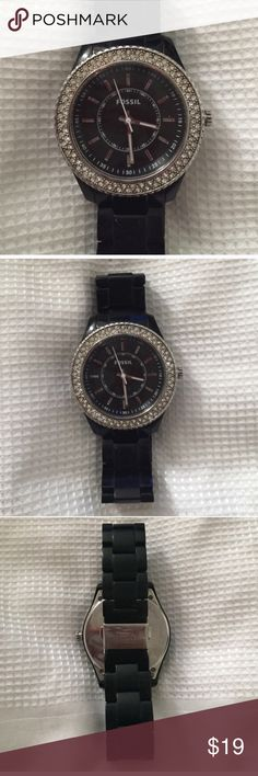 Fossil Watch Beautiful black fossil watch with rhinestones (all rhinestones are there). Battery does not work but can easily be replaced. Comes with all of the original links. The band is black acrylic.Normal wear and tear. Small scratches that aren't very visible.  Ask questions :) Fossil Accessories Watches