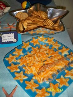 Sea Stars & Sand Dollars. Appetizer made for Under the Sea party. Ritz crackers for sand dollars and colby jack cheese slices cut with mini star cookie cutters for sea stars.