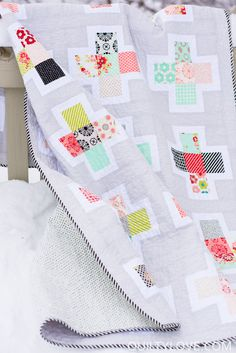 Quilty Love   Handmade fabric Plus Squared Quilt   http://www.quiltylove.com  Modern Plus quilt pattern.