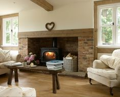 Large hearth, but free-standing wood stove (store wood on hearth.) Only downside is less room for windows.