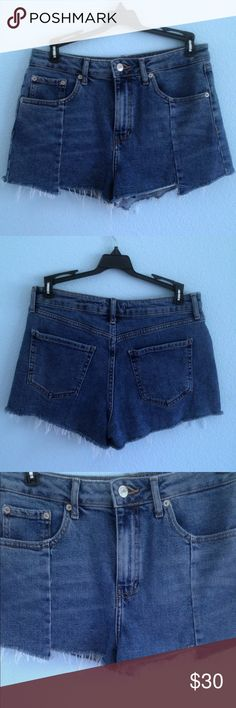 High waisted dark wash Jean shorts In perfect condition. All buttons zippers and pockets work. Best fits a 27/28 or medium Shorts Jean Shorts