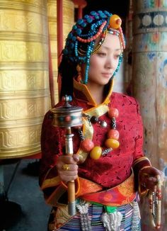 Tibetan Girls in Traditional Dress with lot of Accessories
