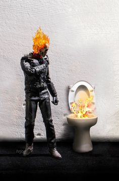 Nobody ever wants to use the john after Johnny Blaze aka Ghost Rider. | This Photographer Puts Superhero Action Figures Into Awkward Poses