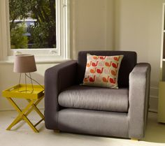 Porto armchair, perfect for a reading corner and is handmade in the UK.