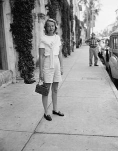 In penny loafers and a sweater set in Palm Beach, 1965   C. Z. Guest Photos Harper's BAZAAR