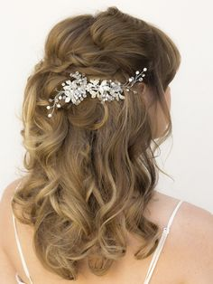 Rhinestone and crystal bridal hair vine comb in a long half up bridal hairstyle by Hair Comes the Bride.