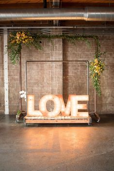 This modern wedding arch was decorated with a marquee light sign and yellow flowers. Check out the spring wedding day on our blog. Spring Wedding Destinations, Destination Wedding Planner, Spring Wedding Inspiration, Wedding Ideas, California Wedding Venues, Marquee Lights, Outdoor Wedding Venues, Ceremony Backdrop, Festival Wedding