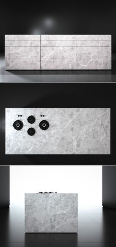 Monolith kitchen from piqu, a contemporary stone island designed to appear as one solid piece of stone. Low plinth, mitred edge details and surface mounted Pitt burners all create the overall effect. Shown here in Eclipso Bianco Granite.