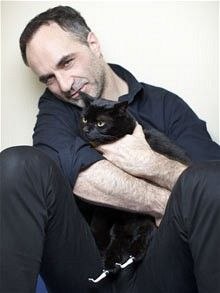 Noel Fitzpatrick with Oscar, the beneficiary of the world's first  prosthetic cat paws