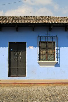 Door of a blue painted house- Antigua, Guatemala