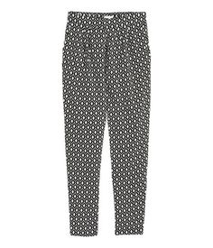 Trousers in a viscose weave with a regular, pleated waist that is elasticated at the back, side pockets and wide, tapered legs.