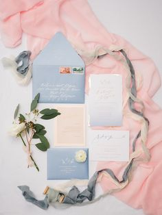 Dusty blue, white, gold and blush wedding invitations