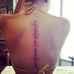 "My spine tattoo, macklemore lyric ""a life lived for art is never a life wasted"""