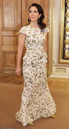 Modern twist: Arriving to the Royal Palace in Stockholm, Sweden, on Saturday evening, Princess Mary donned a modern golden headpiece by Ole Lynggaard - an official jeweller appointed to the Danish Royal Court